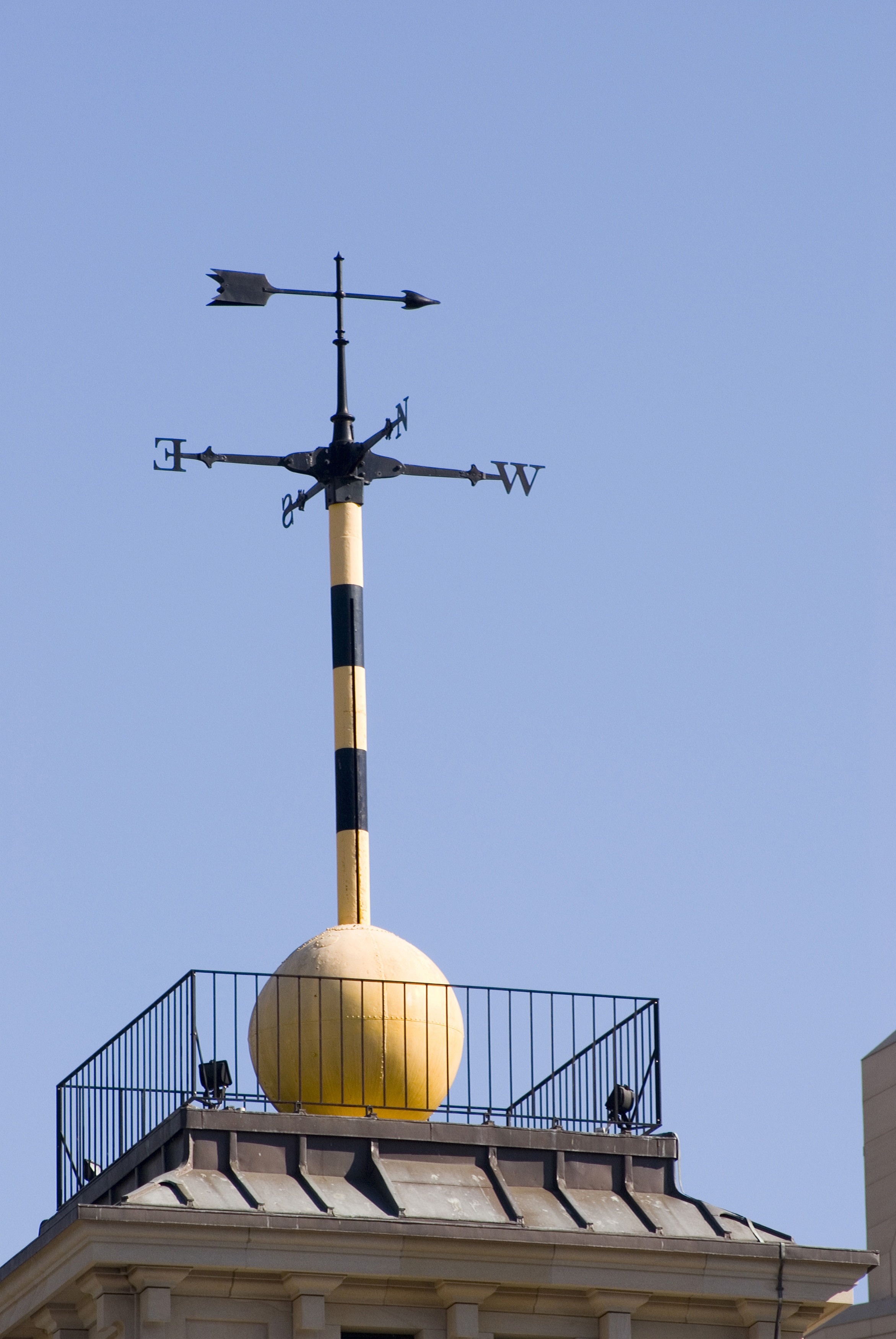 Observatory time ball and weather vane on top of a building, an obsolete time signalling device that was used by mariners to verify marine chronometers when the ball dropped at a specific time