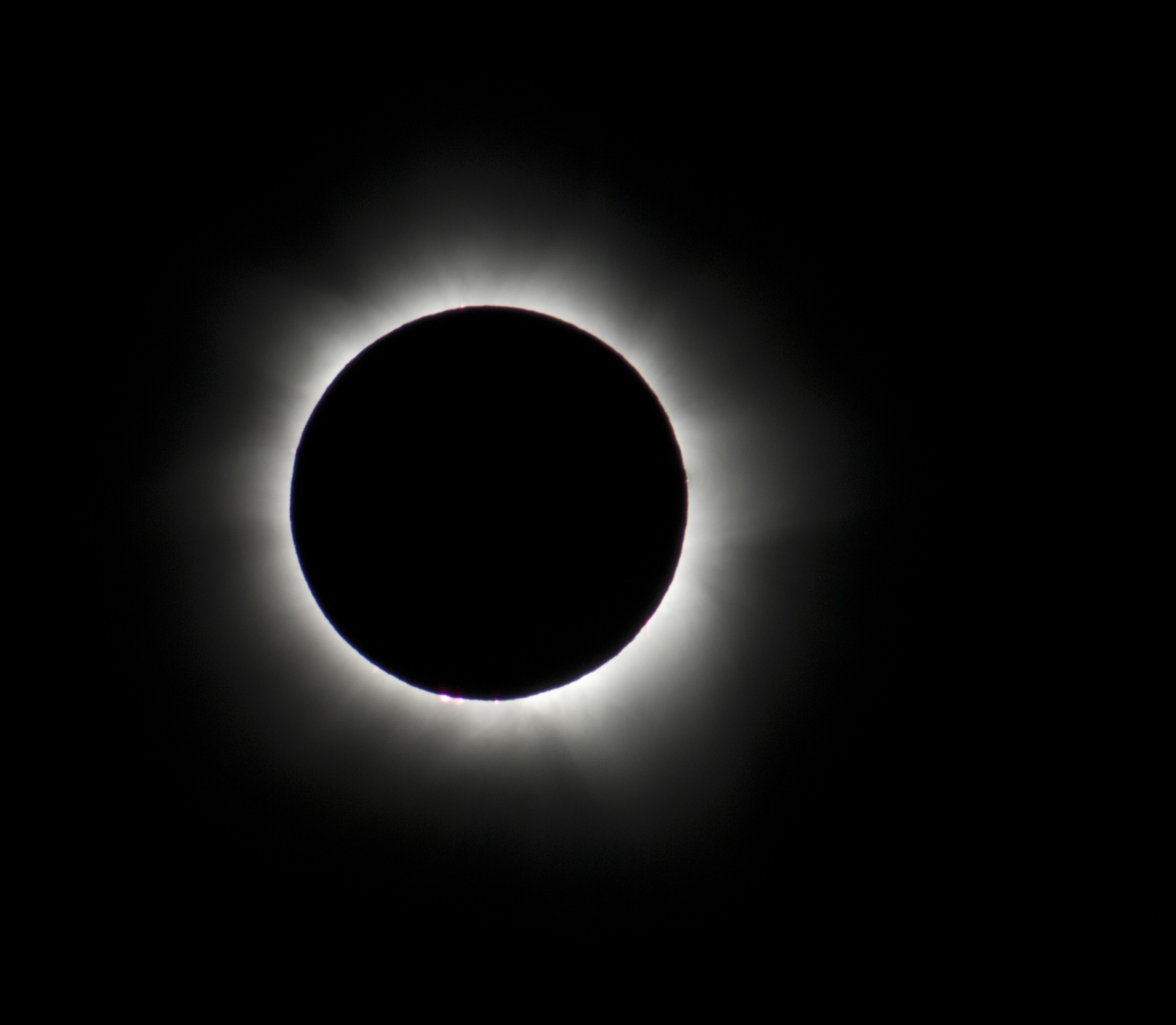 An eclipse in totality, prominences can be seen as can the light reflection from the suns corona