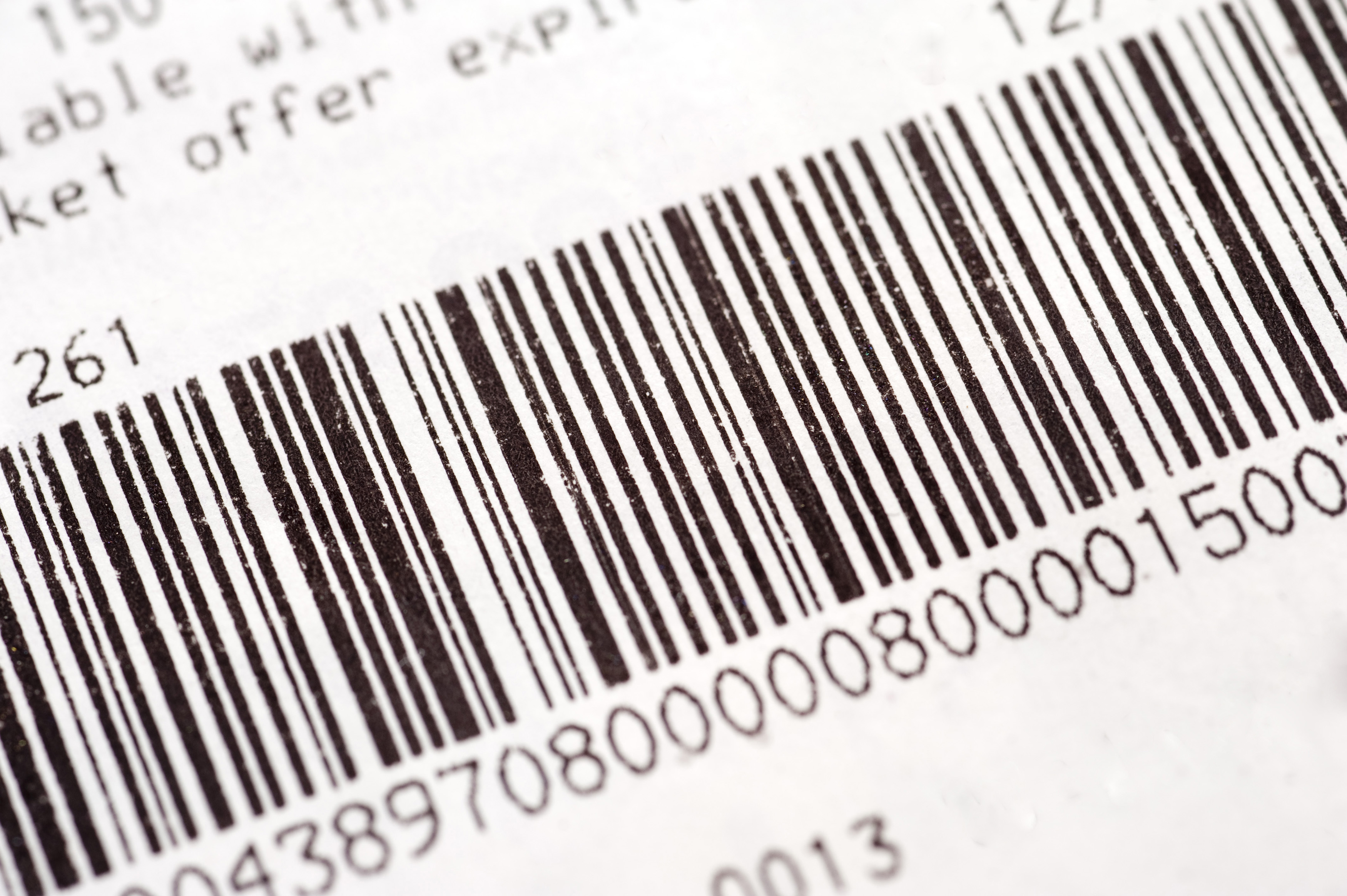 Barcode on a stock item or inventory identifying the description and price by means of bars representing numbers that can be read by a laser scanner